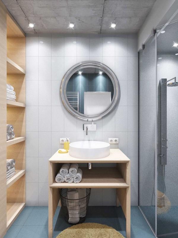 idee amenajare baie cu oglinda rotunda si tavan din ciment